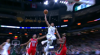 Giannis Antetokounmpo rises up and throws it down