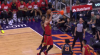 Kelly Oubre Jr. rises to block the shot