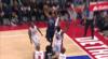 Andre Drummond rises to block the shot