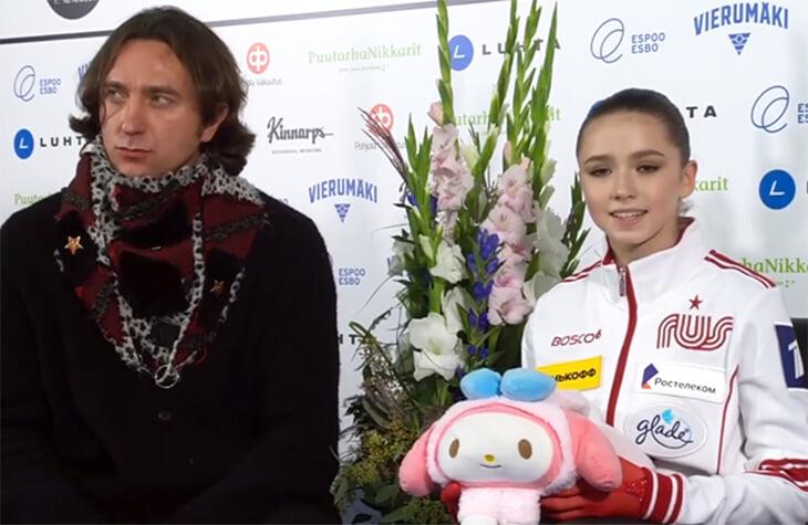 Что за человек в шарфе оказался рядом с Валиевой, когда она получала рекордные оценки?