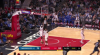 Andrew Wiggins knocks it down as the clock expires
