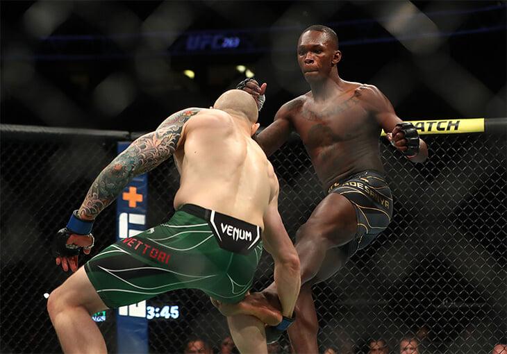 Адесанья просто неуловим: разбил сопернику ногу, ушел от всех ударов и защитил титул UFC. Победу посвятил убитому спарринг-партнеру