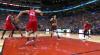 Jakob Poeltl rises to block the shot
