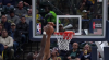 Myles Turner rises to block the shot