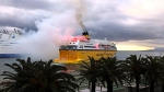 Bastia fans light up a ferry with flares on their way to Monaco for the cup semi final