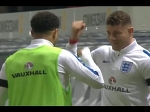 Kyle Walker and Ross Barkley playing rock, paper, scissors at half time